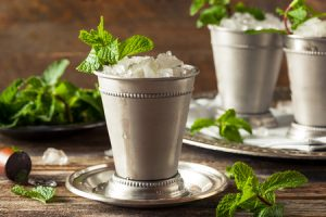 56016514 - cold refreshing classic mint julep with mint and bourbon